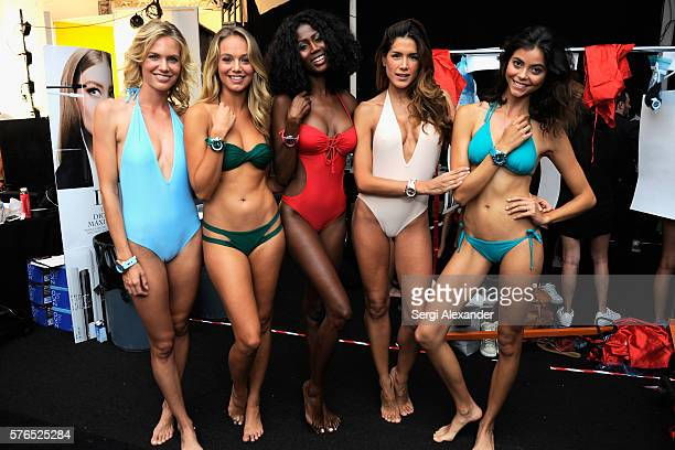 Models pose backstage at the KYBOE Watches Miami Swim Week fashion show on July 15 2016 in Miami Beach Florida