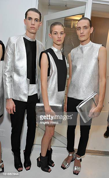 Models pose backstage at the Rad by Rad Hourani Unisex Collection spring 2013 fashion show during MercedesBenz Fashion Week at Studio 450 on...
