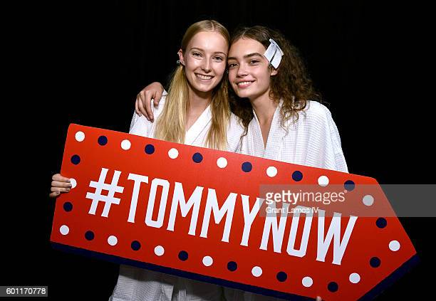 Models pose backstage at the #TOMMYNOW Women's Fashion Show during New York Fashion Week at Pier 16 on September 9, 2016 in New York City.
