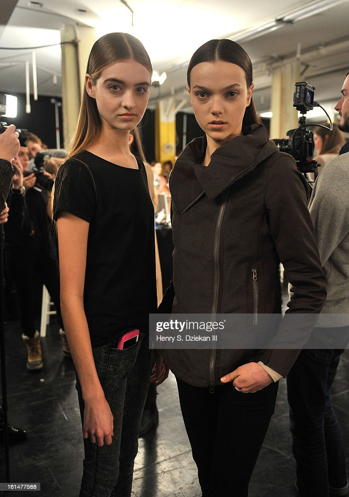 Models pose backstage at Theyskens' Theory during Fall 2013 Mercedes-Benz Fashion Week at Skylight Studios at Moynihan Station on February 11, 2013 in New York City.