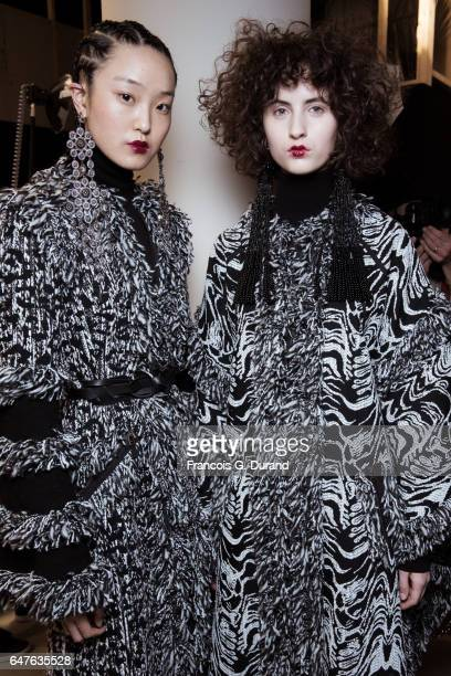 Models pose backstage before the Andrew Gn show as part of the Paris Fashion Week Womenswear Fall/Winter 2017/2018 on March 3 2017 in Paris France