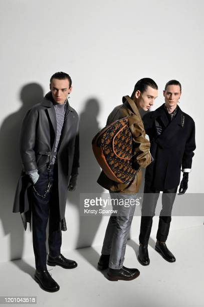 Models pose backstage before the Dior Homme Menswear Fall/Winter 20202021 show as part of Paris Fashion Week on January 17 2020 in Paris France