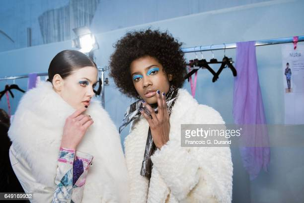 Models pose backstage before the Leonard Paris show as part of the Paris Fashion Week Womenswear Fall/Winter 2017/2018 on March 6, 2017 in Paris,...