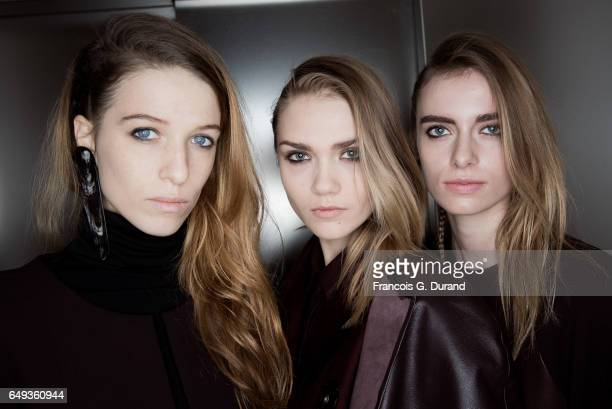 Models pose backstage before the Nobi Talai Paris show as part of the Paris Fashion Week Womenswear Fall/Winter 2017/2018 on March 7 2017 in Paris...