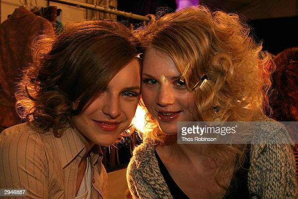 Models pose backstage during Olympus Fashion Week at Bryant Park February 8 2004 in New York City