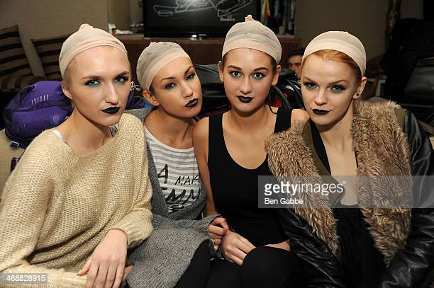 Models pose backstage during the Geoffrey Mac For Sharon Needles fashion show at Out Hotel on February 11 2014 in New York City