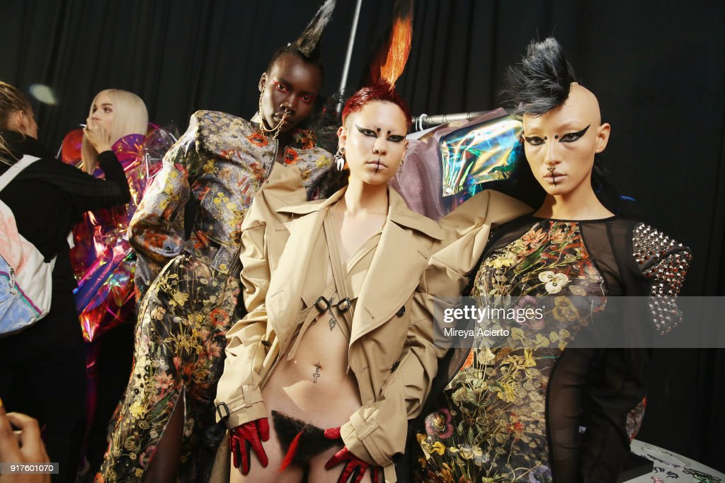 Models pose backstage during the Kaimin fashion show at the Glass Houses on February 12, 2018 in New York City.