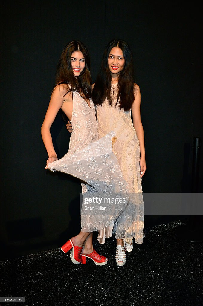 Models pose backstage during the Nanette Lepore show during Spring 2014 Mercedes-Benz Fashion Week at The Stage at Lincoln Center on September 11, 2013 in New York City.