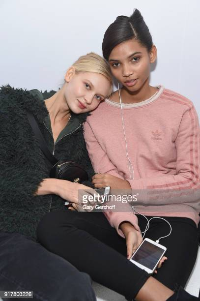 Models pose backstage for Badgley Mischka during New York Fashion Week: The Shows at Gallery I at Spring Studios on February 13, 2018 in New York...