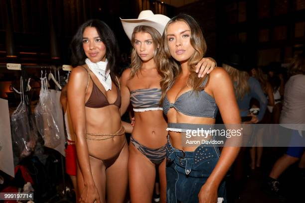 Models pose backstage for Kaohs during the Paraiso Fashion Fair at The Setai Miami Beach on July 14 2018 in Miami Beach Florida