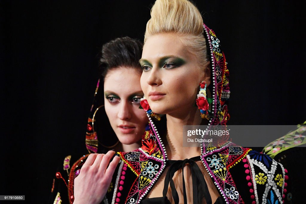 Models pose backstage for Naeem Khan during New York Fashion Week: The Shows at Gallery I at Spring Studios on February 13, 2018 in New York City.