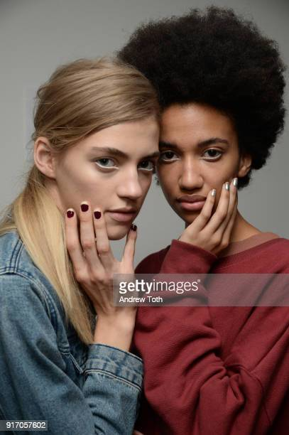 Models pose backstage for Tanya Taylor presentation during New York Fashion Week The Shows at Gallery II at Spring Studios on February 11 2018 in New...