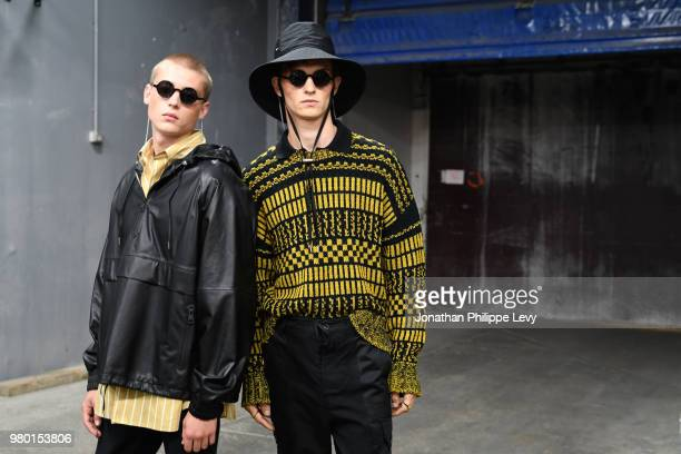 Models pose backstage prior the Ami Alexandre Mattiussi Menswear Spring Summer 2019 show as part of Paris Fashion Week on June 21 2018 in Paris France