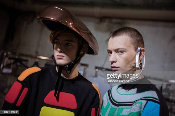 Models pose Backstage prior the Angus Chiang Menswear Fall/Winter 20182019 show as part of Paris Fashion Week on January 18 2018 in Paris France