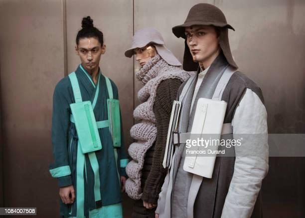 Models pose Backstage prior the Boris Bidjan Saberi Menswear Fall/Winter 20192020 show as part of Paris Fashion Week on January 17 2019 in Paris...