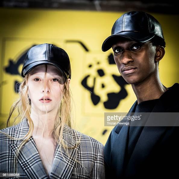 Models pose backstage prior the Juun J Menswear Spring Summer 2019 show as part of Paris Fashion Week on June 22 2018 in Paris France