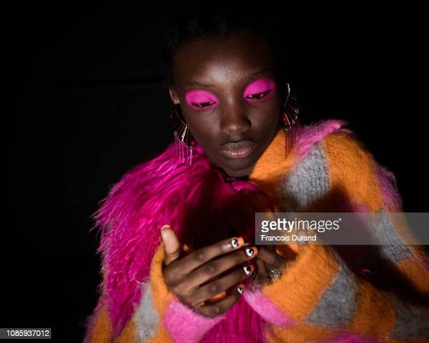 Models pose Backstage prior the Kenzo Menswear Fall/Winter 20192020 show as part of Paris Fashion Week on January 20 2019 in Paris France