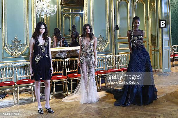 Models pose backstage prior to the Alberta Ferretti Limited Edition Fall/Winter 20162017 show as part of Paris Fashion Week on July 3 2016 in Paris...