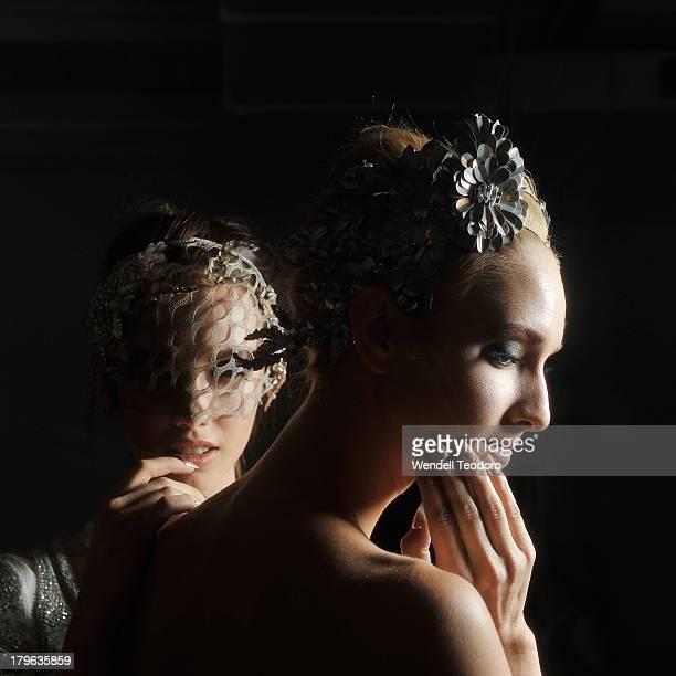Models pose backstage wearing designs by Aurelio Costarella before the Fashion Palette Australia show during Spring 2014 Mercedes-Benz Fashion Week...