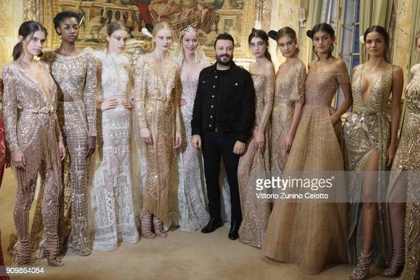Models pose backstage with designer Zuhair Murad prior the Zuhair Murad Spring Summer 2018 show as part of Paris Fashion Week on January 24 2018 in...