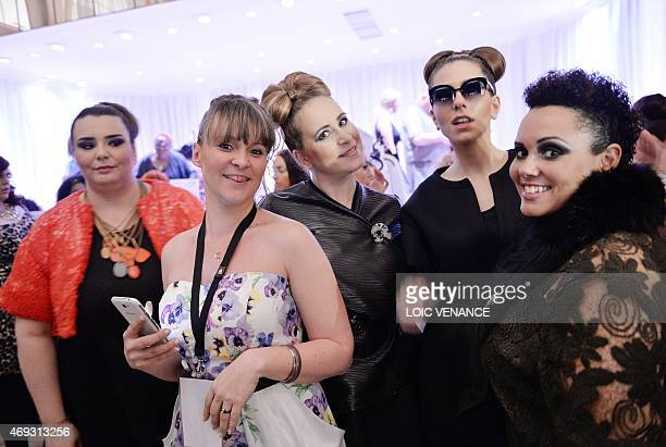 Models pose before a show part of the third edition of the Pulp Fashion Week Paris on April 11 2015 in Paris The Pulp Fashion Week event aims at...