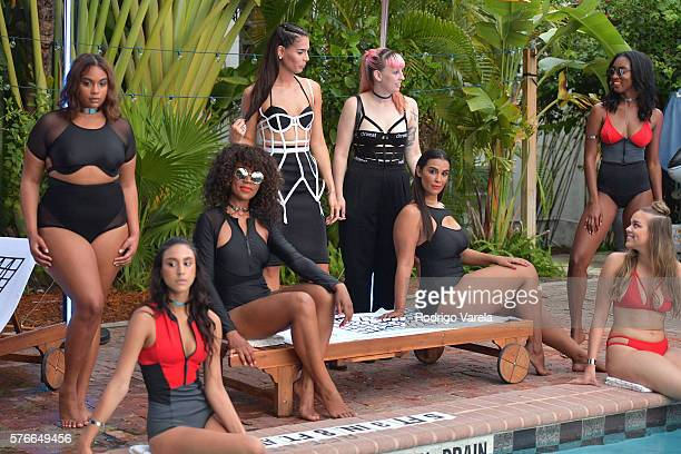 Models pose by the pool at the Chromat Swim Presentation At Dive Swim Week At The Freehand Miami at Freehand Miami on July 16 2016 in Miami Florida