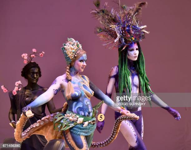 Models pose during a body art competition at the XV International Crystal Angel Festival of Hairdressing Fashion and Design in Kiev on April 22 2017...