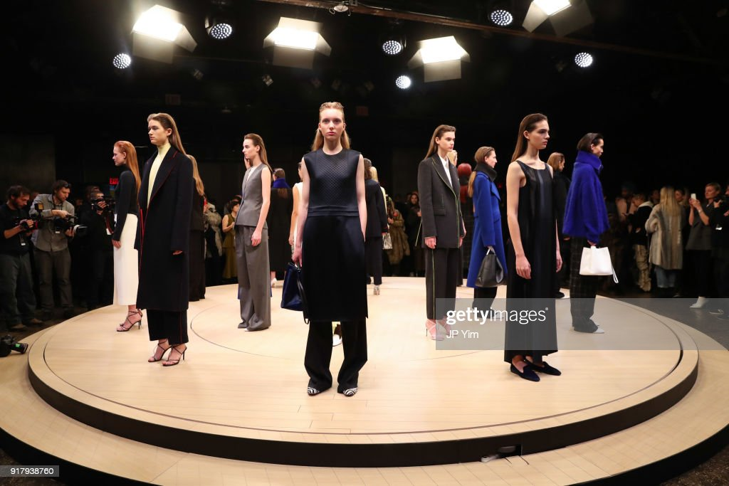 Models pose during BOSS Womenswear Gallery Collection during New York Fashion Week Mens' at Cedar Lake on February 13, 2018 in New York City.