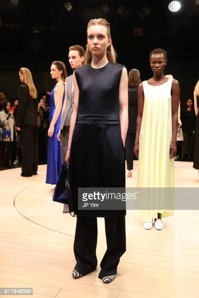 Models pose during BOSS Womenswear Gallery Collection During New York Fashion Week Mens' at Cedar Lake on February 13 2018 in New York City