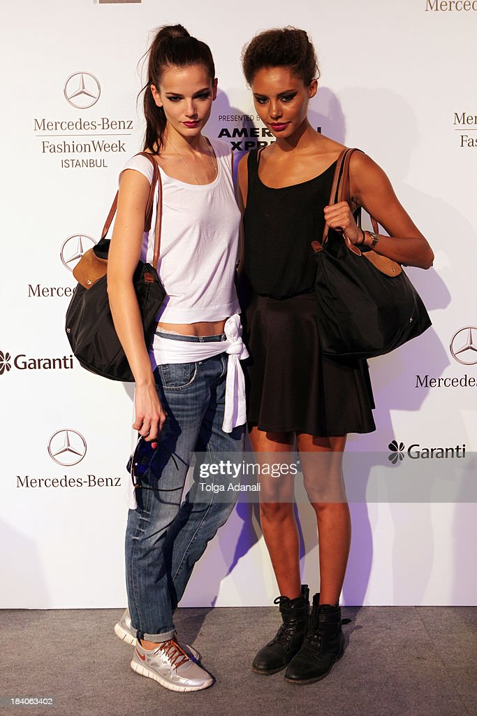 Models pose during Mercedes-Benz Fashion Week Istanbul s/s 2014 presented by American Express on October 11, 2013 in Istanbul, Turkey.
