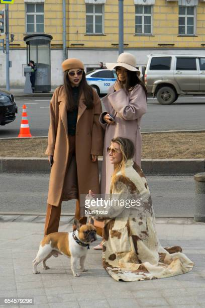 Models pose during Moscow MercedesBenz Fashion Week Fall/Winter 2017/18 in Moscow Russia on 15 March 2017