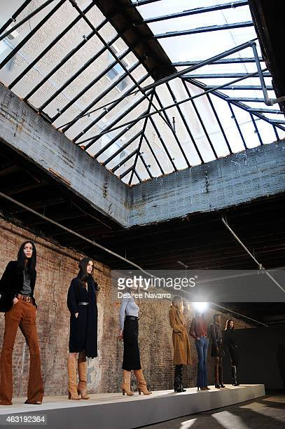 Models pose during rehearsal at the FRAME Denim Presentation MercedesBenz Fashion Week Fall 2015 on February 11 2015 in New York City