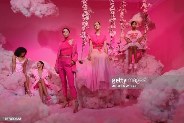 TOPSHOT Models pose during the alice olivia by Stacey Bendet Spring 2020 Fashion Presentation at Root Studio during New York Fashion Week The Shows...
