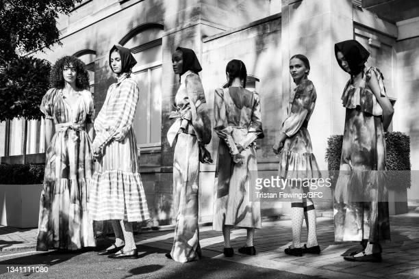 Models pose during the Anna Mason Presentation during London Fashion Week September 2021 on September 18, 2021 in London, England.