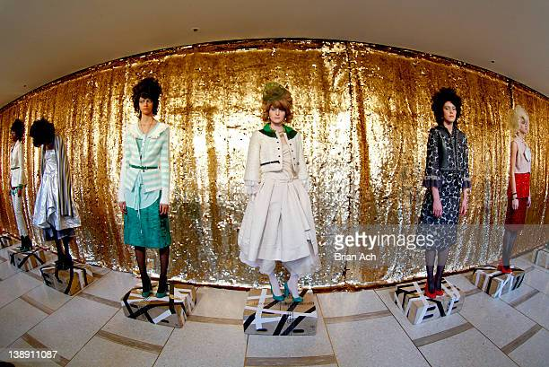 Models pose during the Chris Benz fall 2012 presentation during MercedesBenz Fashion Week at Avery Fisher Hall Grand Promenade on February 13 2012 in...