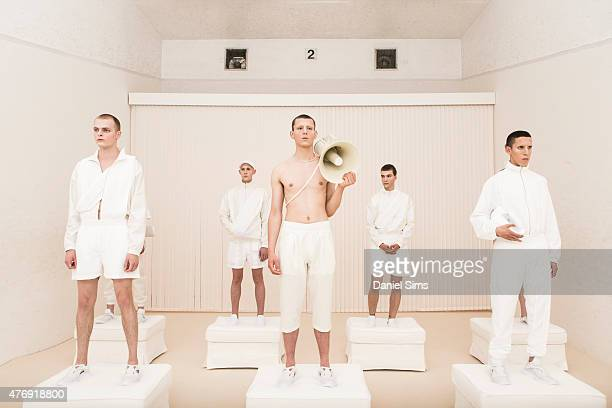 Models pose during the Cottweiler presentation during The London Collections Men SS16 at on June 12, 2015 in London, England.