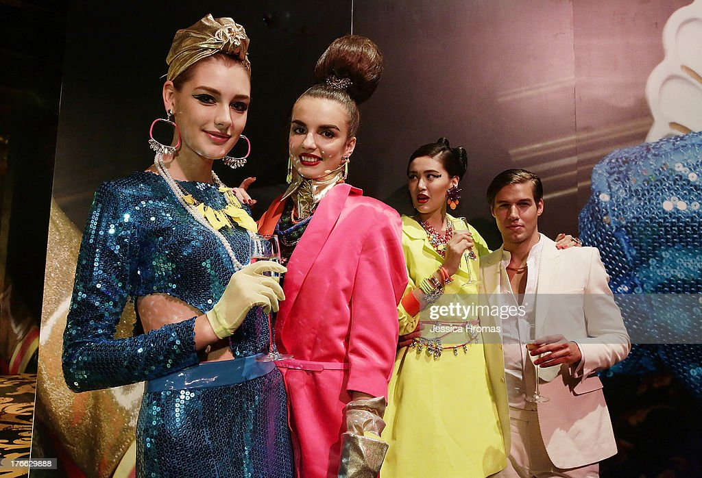 Models pose during the 'Dazzling M.A.C Indulge Event' to launch their Fall 2013 luxury line of cosmetics on August 16, 2013 in Hong Kong, Hong Kong.