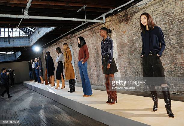 Models pose during the FRAME Denim Presentation MercedesBenz Fashion Week Fall 2015 on February 11 2015 in New York City