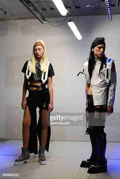 Models pose during the Hood By Air presentation as part of the Paris Fashion Week Womenswear Spring/Summer 2015 on September 23 2014 in Paris France