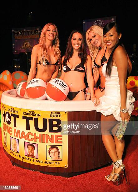 Models pose during the Hot Tub Time Machine Bluray and DVD launch party at the Kandyland V red carpet at the Playboy Mansion on June 26 2010 in Los...