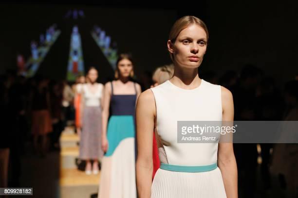 Models pose during the Hugo Boss Live Presentation during 'Der Berliner Mode Salon' Spring/Summer 2018 at St Agnes Church on July 6 2017 in Berlin...
