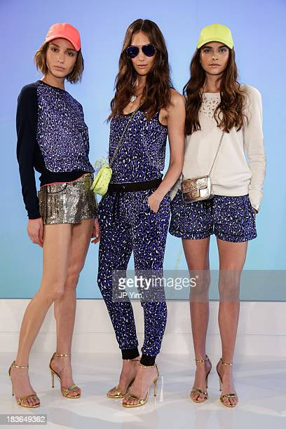 Models pose during the Juicy Couture spring 2014 presentation at Milk Studios on October 8 2013 in New York City