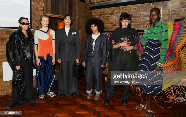 Models pose during The London Seven Collective, LCF Graduate Screening during London Fashion Week June 2021 on June 14, 2021 in London, England.
