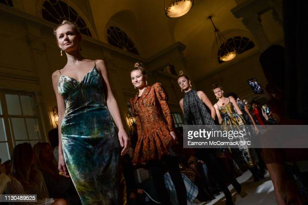 Models pose during the Paul Costelloe presentation during London Fashion Week February 2019 at the Simpsons in the Strand on February 18, 2019 in...