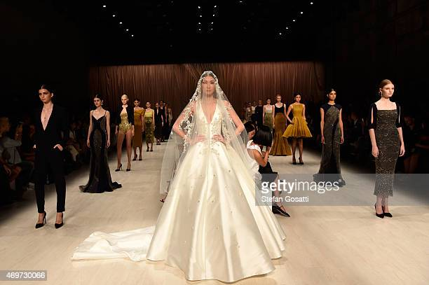 Models pose during the Steven Khalil show at MercedesBenz Fashion Week Australia 2015 at Carriageworks on April 15 2015 in Sydney Australia