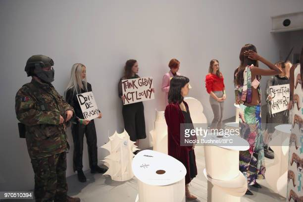 Models pose during the VIN OMI press launch at London Fashion Week Men's June 2018 at 180 The Strand on June 9 2018 in London England