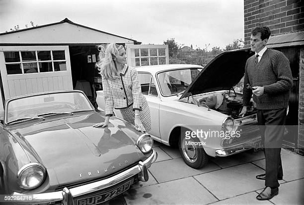 Models pose for a Lolly Dolly wives feature in Manchester Man and woman and child in a suburban neighbourhood November 1969 Z11174004
