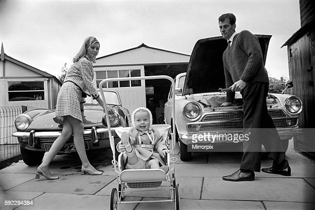 Models pose for a Lolly Dolly wives feature in Manchester Man and woman and child in a suburban neighbourhood November 1969 Z11174001