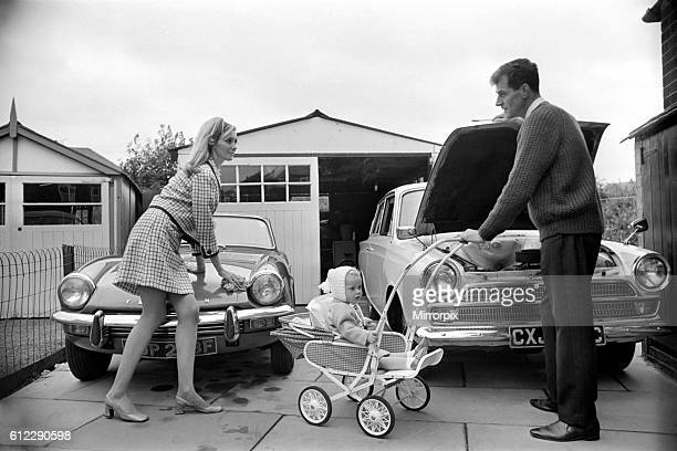 Models pose for a Lolly Dolly wives feature in Manchester Man and woman and child in a suburban neighbourhood November 1969 Z11174011