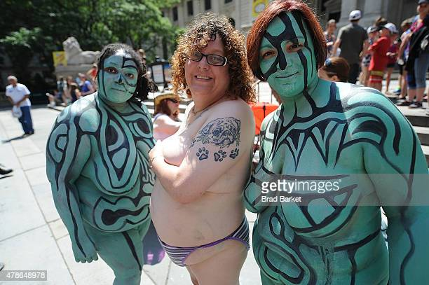 Models pose for a photo after being painted by artist Andy Golub duning Bodypainting day on June 26 2015 in New York City